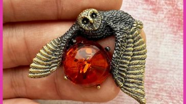Flying owl brooch. Brass and amber